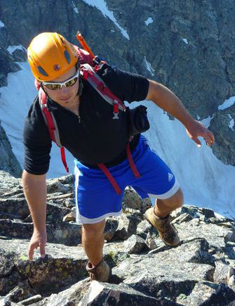 Brett Woelber climbing mountains