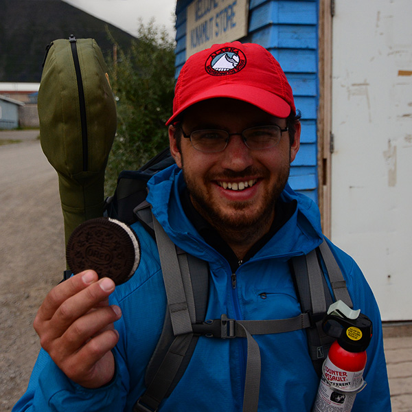 Holding an ice cream sandwich outside of the general store in Anaktuvuk Pass