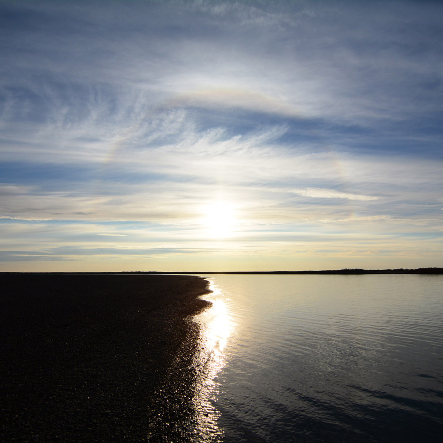 A fainy sun halo hangs over the Colville River, in the Alaska Arctic