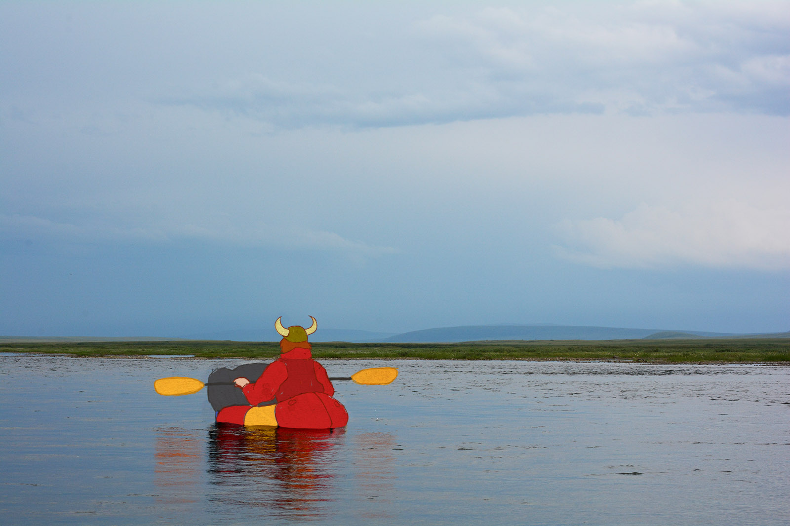 Jason Mercer, wearing a Viking hat, rafts down the Anaktuvuk River, with the hills of the North Slope off in the blue haze