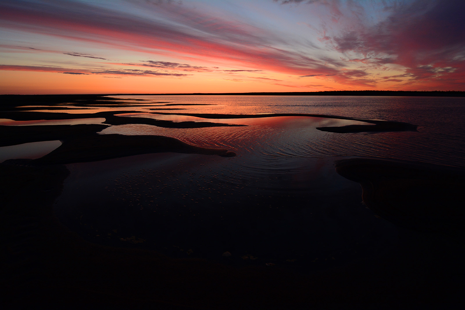 A colorful sunset over the Colville River, on the North Slope of Alaska