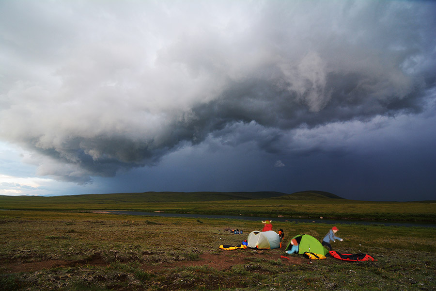 Storm clouds approach a camp on the North Slope, Alaska